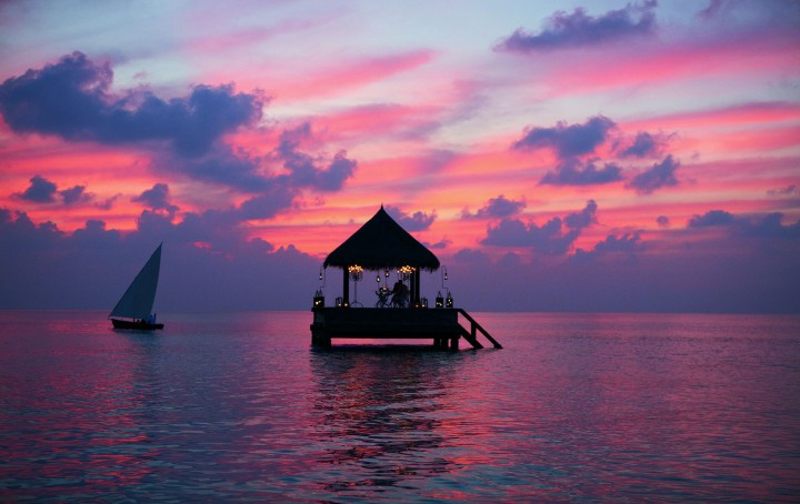 Maldives-sunset-with-a-boat-and-a-house